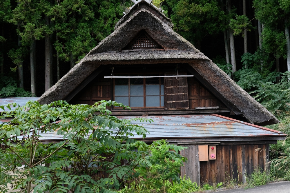 Traditional Japanese Thatched Roof Houses by Lake Kawaguchi